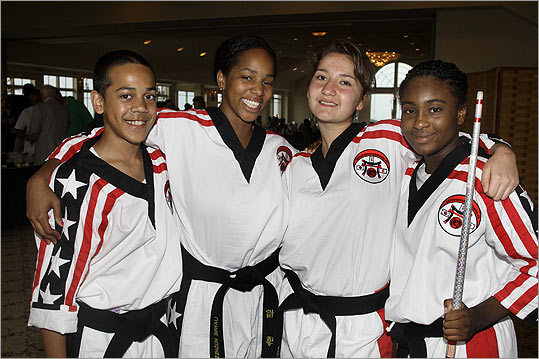 June 28 in Quincy From left: P.A.L.'s Karate Team members Brendon Gonzalez of Dorchester, Lianne Hughes of South End, Kelsey Galeano of Jamaica Plain, and Chane Vanes of Roxbury.