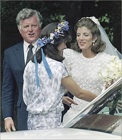 Caroline chats with her cousin and matron of honor, Maria Shriver (center) on her wedding day. Their uncle, Senator Ted Kennedy is at left.