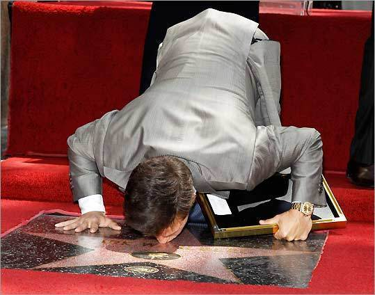 Wahlberg gave his star a kiss.