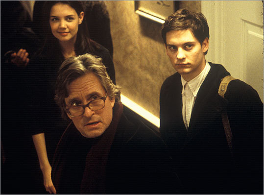 15. ' Wonder Boys ' (2000) Michael Douglas (center) stars as Grady Tripp, an English professor and writer who is on the back end of his career and at a serious crossroads, personally and professionally. Tobey Maguire (right) and Katie Holmes play students who unwittingly guide him.