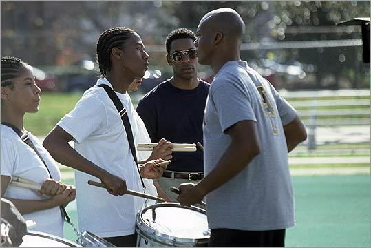 19. 'Drumline' (2002) 'A Harlem bucket drummer (Nick Cannon, at left of center) gets a scholarship to fictional Atlanta A&T University, wins himself the head cheerleader, provokes tension, and pile drives adversity' in this film that makes band geeks look cool, writes the Globe's Wesley Morris . Pictured: Cannon with Leonard Roberts and Orlando Jones.