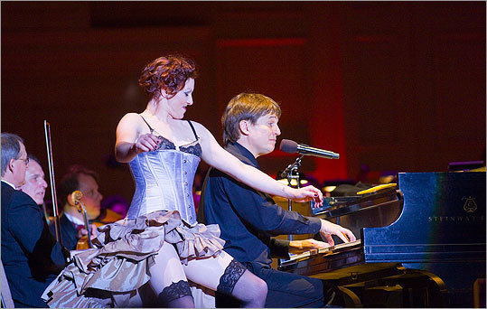 In 2008, Palmer performed with the Boston Pops at Symphony Hall. Here she is cozying up to conductor Keith Lockhart on piano.