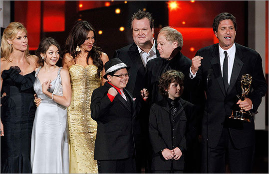 Steven Levitan and the cast of 'Modern Family' celebrated their award for outstanding comedy series. Pictured from left: Julie Bowen, Sarah Hyland, Sofia Vergara, Rico Rodriguez, Eric Stonestreet, writer Danny Zuker, Nolan Gould, and Steven Levitan.
