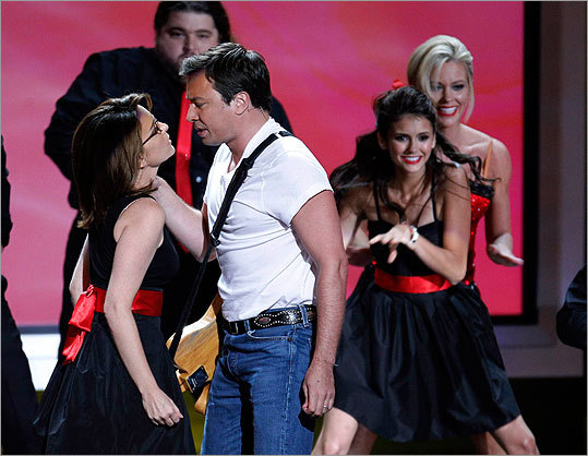 Jimmy Fallon and Tina Fey on stage during the opening number.