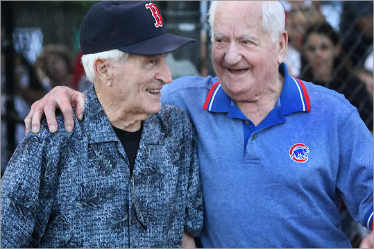 Over 2,000 guests attended the 17th Annual Oldtime Baseball Game held at St. Peter's Field. This year's event benefited The Marley Jaye Cherella Memorial Fund, which is dedicated to supporting research into Sudden Infant Death Syndrome (SIDS) at Boston Children's Hospital. ky (left) with Chicago Cubs 1945 World Series infielder Lennie Merullo of Reading.