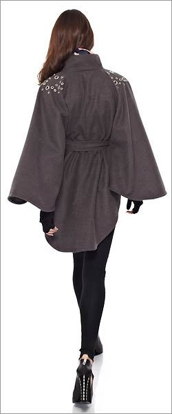 "A CAPE OR PONCHO Think it takes a special person to pull off a cape? Well, this might be the season to try it. ""Let's be honest, a cape or poncho are chic in a woman's wardrobe,'' Downing says. Michael Kors, Halston Heritage, and Giorgio Armani are just a few of those who've come out with traditional, regal-looking capes this season. If you want to try something a little different, look for Juicy Couture's cropped houndstooth cape or Wink's Carly cape."