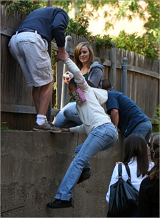 During filming for 'The Town' on Sept. 26, 2009, a group of curious fans climbed a wall behind the McDonalds as they tried to catch a glimpse of Ben Affleck through a hole in the fence.