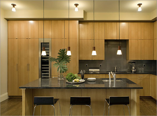 Exotic wood and Jet Mist black granite in this Back Bay kitchen.