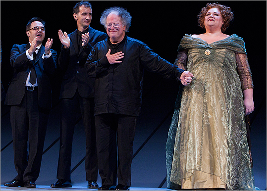 The Metropolitan Opera unveiled a major new staging of Wagner's 'Das Rheingold' on Sept. 27, yet before a single note was played the audience rose to its feet to give James Levine an extended welcome-back ovation. The music director of both the Met and the Boston Symphony Orchestra has been out on a prolonged medical leave recovering from back surgery last April. In his bows at the end of the night, he looked trimmer than when last seen in Boston and walked gingerly with support from one of the opera's stars. He was clearly thrilled to be back before a live audience. ( Read the full review by Jeremy Eichler ) View photos from the production... From left: Francois St-Aubin, costume designer, Carl Fillion, set designer, James Levine and Stephanie Blythe taking their bows at the end of the performance.