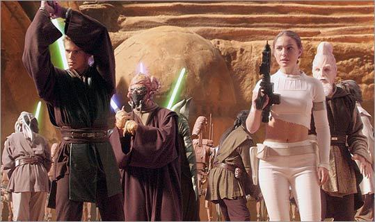 In May 2002, she got to dust off her light saber in her return to the 'Star Wars' franchise for 'Episode II: Attack of the Clones,' alongside Hayden Christensen (left).