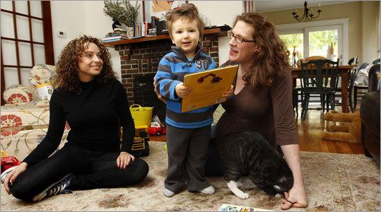 Joanna Szukala and mom Morra Aarons-Mele are pictured with Asa Mele