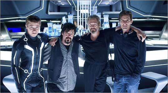 Actor Garrett Hedlund, producer Steven Lisberger, actor Jeff Bridges, and director Joseph Kosinski on the set of 'Tron: Legacy.'
