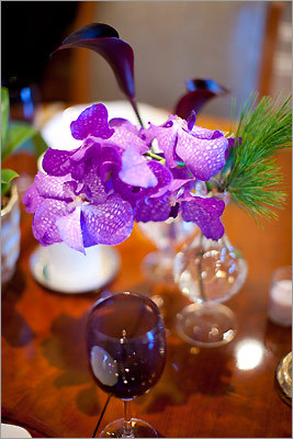 An orchid and decorative vase designed by Winston Flowers.