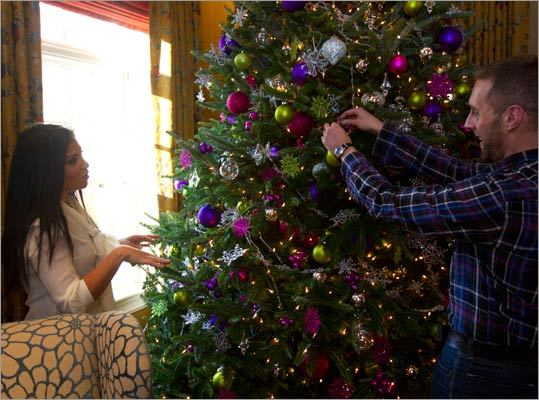 Shannon and Ryan decorated the Allen's 12-foot Christmas tree.