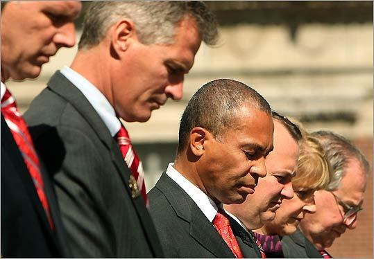 From left: State Treasurer Tim Cahill, SenatorScott Brown, Governor Deval Patrick, Lt. Governor Tim Murray, Attorney General Martha Coakley, and House Speaker Robert DeLeo at a memorial service for fallen firefighters at the State House.