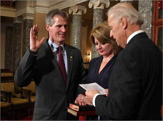 Vice President Joe Biden (right) swore in Senator Scott Brown as a US senator on Feb. 4. Brown took the oath on his daughters' Bibles, held by his wife, Gail Huff.