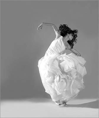 White by Vera Wang Polyester organza dress, $1,200 at David's Bridal; Oscar de la Renta silk satin pumps, $635 at L'Elite; Ti Adoro freshwater pearl earrings, $45 at Country Weddings Bridal Boutique.
