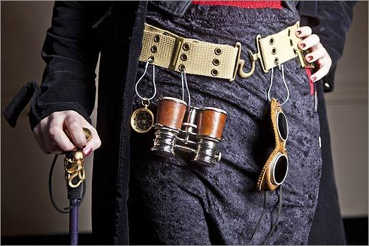 Among the hardware worn by Jacqueline Kern, 23, of Littleton, are a pair of opera glasses, leather period goggles, and a cane with a doorknob handle.