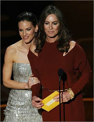 Hilary Swank brought out last year's best director winner Kathryn Bigelow to present Tom Hooper with this year's award for 'The King's Speech.'