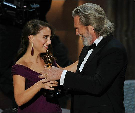 Portman accepted the award from best actor nominee Jeff Bridges.