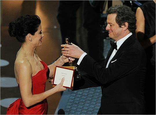 Firth accepted the best actor award from last year's best actress winner, Sandra Bullock.