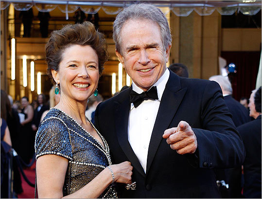 Annette Bening, best actress nominee for her role in 'The Kids Are All Right' and a presenter during the show, and husband Warren Beatty.