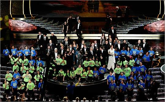 The student choir from the New York City/Staten Island School PS 22 performed as the Oscar winners joined them onstage to close the show.