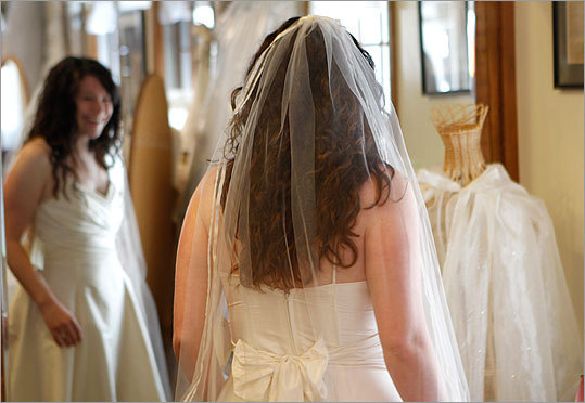 Alterman is surprised by how much she likes a veil while shopping for a dress at Maggie Flood.