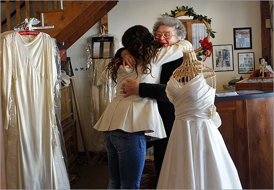 Alterman gives a big hug to Nancy Erickson, owner of Maggie Flood in Sudbury, after having a better than expected wedding dress shopping experience.