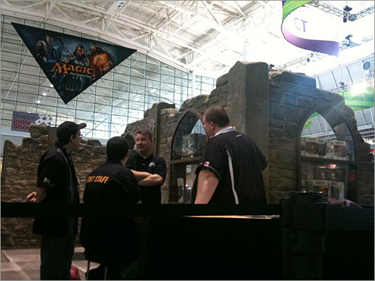 The booth at PAX East for Dungeons & Dragons. Wizards of the Coast, which owns and develops D&D also makes Magic: The Gathering, the popular collectible card game with more than twelve million players in over seventy countries. Wizards was debuting screenshots and a teaser trailer for a game called Duels of the Planeswalkers 2012 for Xbox LIVE Arcade, PC/Steam, and PlayStation.