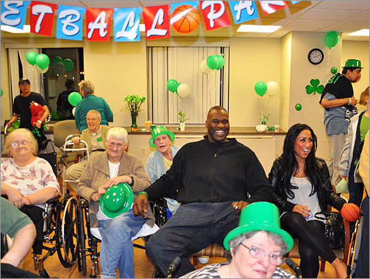 March 14 in Boston Celtic Shaquille O'Neal surprised patients at the Spaulding Nursing and Therapy Center North End during its Celtics Viewing Party on Monday night. He was joined by his girlfriend, Nikki 'Hoopz' Alexander.