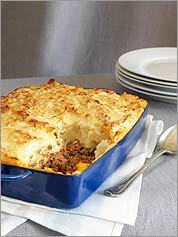 WORTH A TOAST Cheese and mashed potatoes brown on top of this hachis Parmentier .