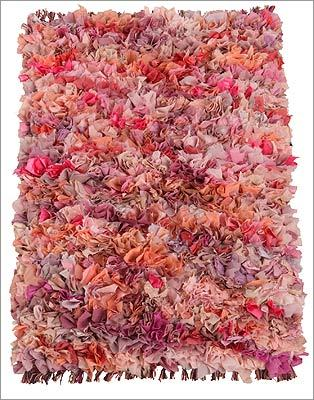 "URBAN OUTFITTERS ""Mixed Media"" polyester and cotton shag rug in pink, $28, available online at http://www.urbanoutfitters.com"