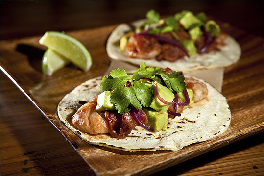 Spicy shrimp tacos with bacon, avocado, and pickled onions.