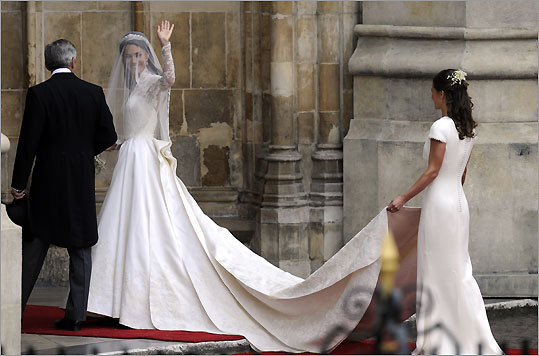 Kate Middleton waved as she arrived with her father, Michael Middleton, and her sister, Philippa Middleton, to the West Door of Westminster Abbey in London for her wedding to Britain's Prince William on Friday, April 29, 2011.