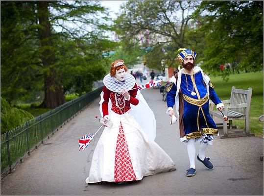 A couple in costume strolled through a park early in the morning of the wedding of Prince William and Kate Middleton.