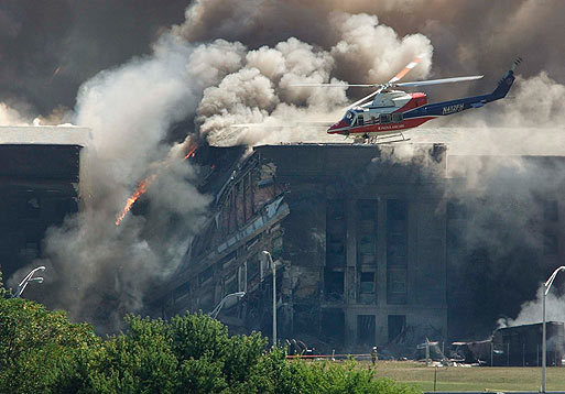 A rescue helicopter surveyed damage to the Pentagon as firefighters battled flames after an airplane crashed into the US military headquarters outside of Washington in this Sept. 11, 2001, file photo. Another 184 people were killed during the attack on the Pentagon.