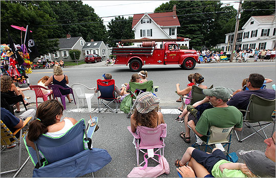 PRIME LOCATION Insiders know to reserve their spot ahead of time for Newburyport's annual Yankee Homecoming parade along High Street.