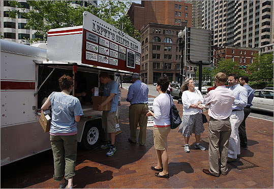 Food trucks are in operation, including a designated area on the waterfront, according to the Boston Redevelopment Authority website . At left, a food truck downtown. For a complete map, visit the City of Boston website .