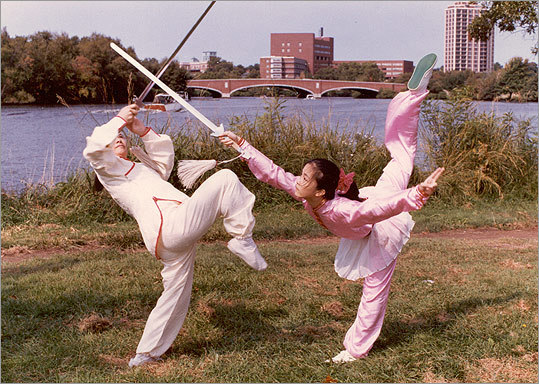 Mark fences with daughter Chris Yen along the Charles River in 1984.