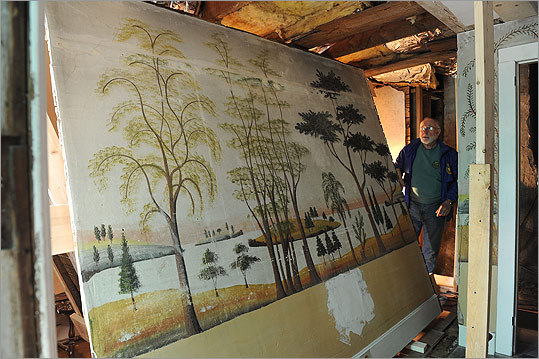 Glenn Haines moves past a section of mural cut from a wall. 'These walls were once the best-kept secret in town,' said the retired Coast Guard captain and antiques dealer.'It breaks my heart to sell the house, but it has to be done. And I'm glad these panels are going into the public domain.'