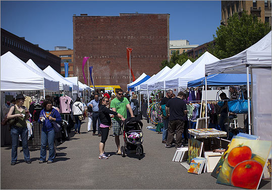 Artists, artisans, and designers sell their handmade items - from art and home accessories to clothing, jewelry, and baby gifts - at the weekly SoWa Open Market in the South End. — Marni Elyse Katz for the Boston Globe Magazine