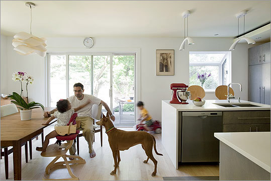 Play time: A big believer in using built-ins sparingly in order to keep spaces flexible, Architect Maggie Booz of Cambridge-based Smart Architecture counseled the couple to forgo them in the dining room. Sure, toys are scattered around the open space now, but it's worth it. Soon enough, the kids will outgrow their toys, she promised, and the proper amount of space needed for a smooth-flowing dining room will have been preserved.