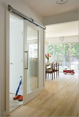 Hall order: The sliding door at the entry was a splurge, but sets the home's modern tone right away.