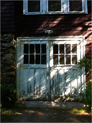 Behind door number one: A garage door project from New England Overhead Door replaced crumbling originals with a popular carriage-house style.