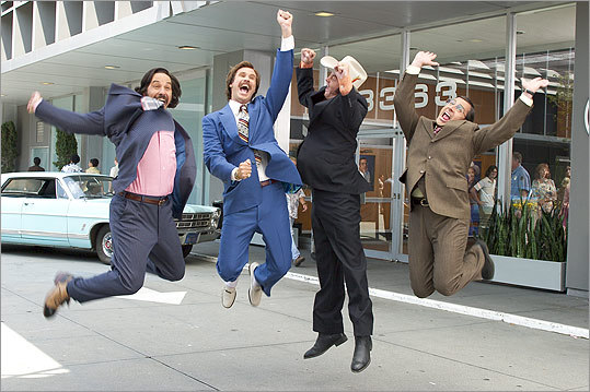 'Anchorman: The Legend of Ron Burgundy' (2004): From left to right, Brian Fantana (Paul Rudd), Ron Burgundy (Will Ferrell), Champ Kind (David Koechner), and Brick Tamland (Carell) celebrate being named San Diego's top-rated news team.