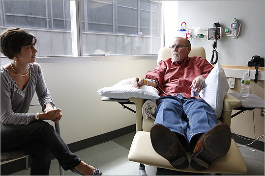 BODY AND MIND Paul White, shown here at a chemotherapy session with his daughter Laurie Alexander, gets help with pain management and treatment decisions from MGH's palliative care team.