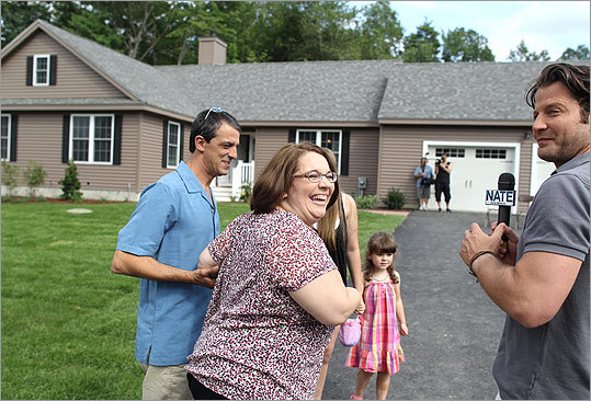 Nate Berkus (right), Oprah Winfrey's celebrity designer, was in Ayer on August 5 changing the life of a family that's been through a lot. Berkus unveiled a customized, 1,900-square-foot house for quadruple-amputee Monica Jorge (center), her husband, Tony (left), and their two daughters. The ranch has a garage with a ramp into the house, a customized kitchen with a side-opening oven, wide bathrooms, and a chairlift to go downstairs to the basement. Read the Names story