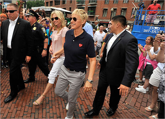 The pair made their way through the crowd and to the steps of Faneuil Hall.
