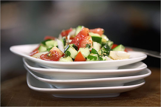 Middle Eastern salad Served in many Middle Eastern cultures at meals all day - including breakfast - this finely chopped salad of cucumbers, ripe tomatoes, and onions is offered with thick slices of feta and triangles of pita. Full recipe